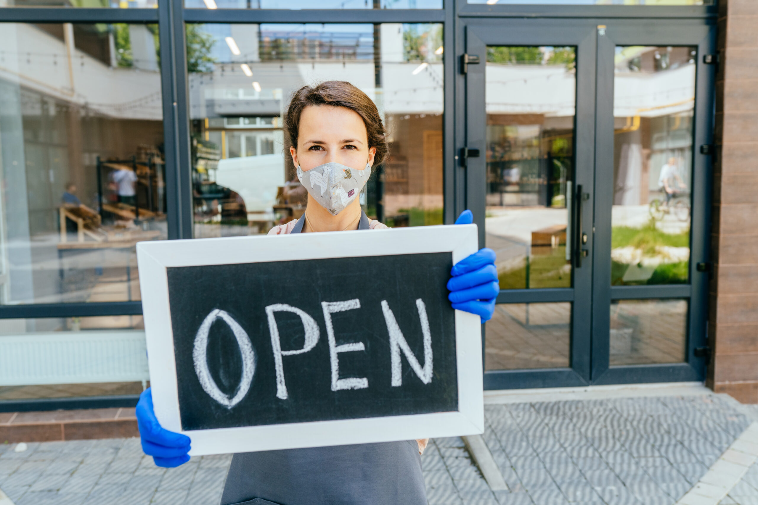 Small business woman with open sign